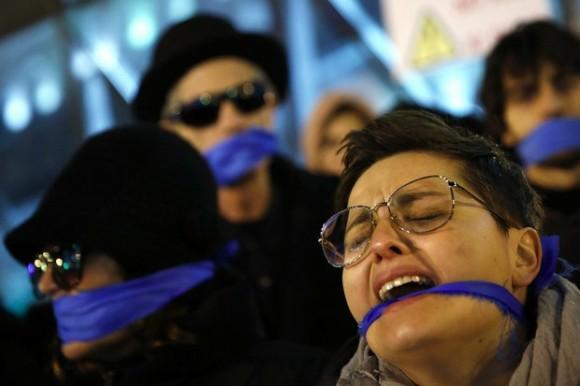 Manifestantes protestan contra la nueva ley de seguridad del gobierno español en Madrid, el 10 de diciembre de 2014. Foto Reuters