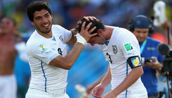 Luis Suárez y Diego Godín.