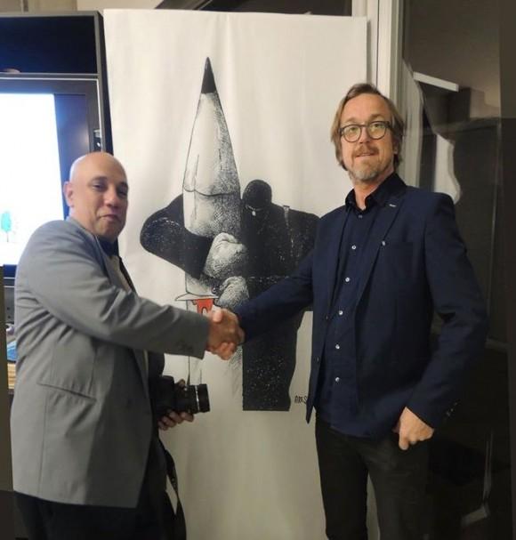 Ares y el premiado caricaturista belga Lux Descheemaker, conocido como O Sekoer.