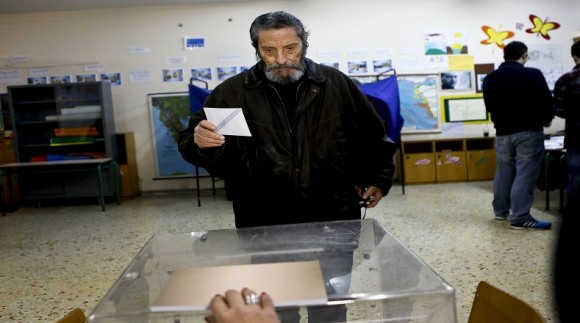 A man prepares to cast his vote for the Greek parliamentary elections in Athens