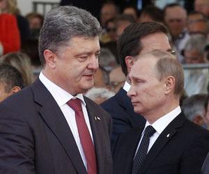 Poroshenko (izquierda) y Putin. Foto: Christophe Ena.