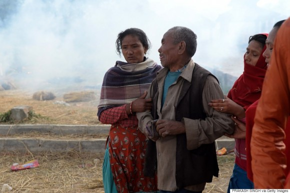 Krishna Bhakta Koju (C) breaks down at the cremation of his daughter who was one of the victims of earthquake in Bhaktapur on the outskirts of Kathmandu on April 26, 2015. International aid groups and governments intensified efforts to get rescuers and supplies into earthquake-hit Nepal on April 26, but severed communications and landslides in the Himalayan nation posed formidable challenges to the relief effort.  AFP PHOTO/PRAKASH SINGH        (Photo credit should read PRAKASH SINGH/AFP/Getty Images)