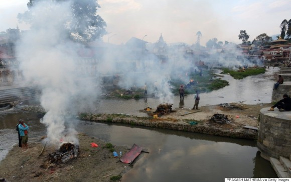 People burn the bodies of earthquake victims at a mass cremation at Pashupatinath in Kathmandu on April 26, 2015. Aid groups and governments worldwide intensified efforts April 26 to help earthquake-hit Nepal, but blocked roads, downed power lines and overcrowded hospitals posed formidable challenges in an already poor country.  AFP PHOTO / PRAKASH MATHEMA        (Photo credit should read PRAKASH MATHEMA/AFP/Getty Images)