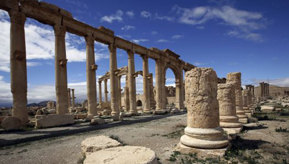 A picture taken on March 14, 2014 shows a partial view of the ancient oasis city of Palmyra, 215 kilometres northeast of Damascus. Syria's fabled desert Greco-Roman oasis of Palmyra saw its last tourist in September 2011, six months after the uprising began. Its most recent visitors are violence and looting. AFP PHOTO/JOSEPH EID        (Photo credit should read JOSEPH EID/AFP/Getty Images)