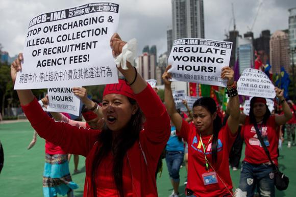 Marcha por la mejora de los salarios y los derechos de los trabajadores en Hong Kong, China.