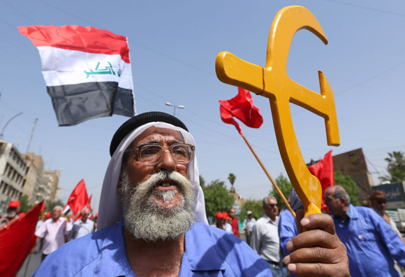 Seguidores del Partido Comunista iraquí durante la celebración del Día del Trabajador en Bagdad, Iraq.