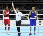 El cubano Andy Cruz ( rojo ), vencedor ante el dominicano Héctor García, en la final  de la división de los 56 kilogramos del boxeo, correspondiente a los XVII Juegos Panamericanos de Toronto, Canadá, el 24 de julio de 2015. AIN FOTO/ Roberto MOREJON RODRIGUEZ