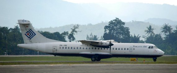 A Trigana Air passenger plane arrives at Jayapura airport on August 17, 2015 as the local carrier continues operations while the National Search and Rescue Agency (Basarnas) locates the wreckage one of the company's ATR 42-300 twin-turboprop planes that crashed in Papua province the day before. Bad weather hampered efforts on August 17 to reach debris in the remote eastern Indonesian mountains in Papua believed to be from the Trigana Air plane that crashed carrying 54 people and cash worth almost half a million USD.      AFP PHOTO / BIMA SAKTI