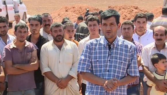 Abdullah Kurdi, el padre, hablando en el entierro. Foto: AP
