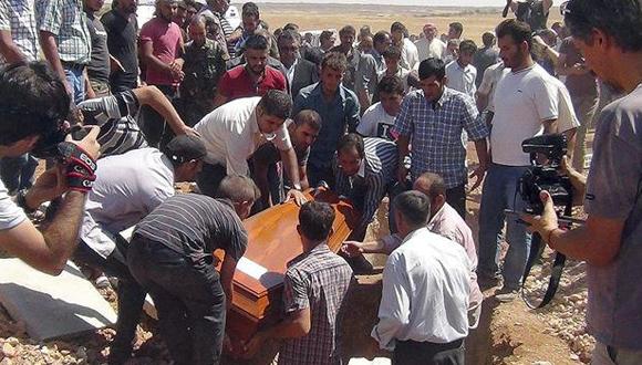 Dolor en el entierro de Aylan Kurdi, su hermano y su mamá. Foto: EFE