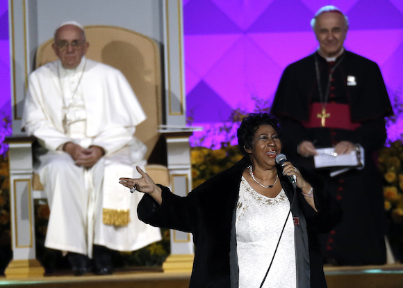 Aretha Franklin performs as Pope Francis is seated nearby during the Festival of Families, Saturday, Sept. 26, 2015, in Philadelphia. (AP Photo/Matt Slocum)