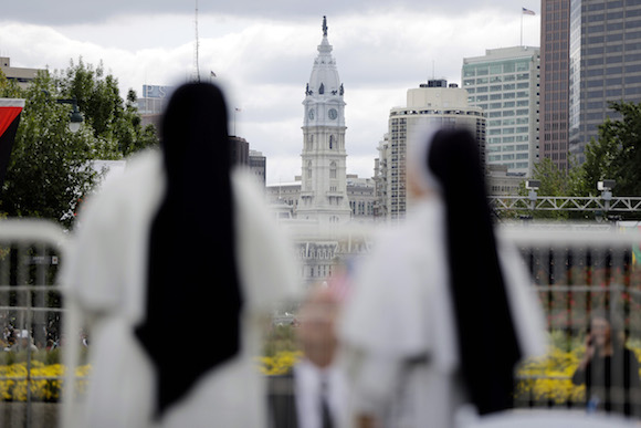 Dominican Sisters from Nashville, Tenn., stand in view of City Hall ahead of the Festival of Families Saturday, Sept. 26, 2015, in Philadelphia. (AP Photo/Matt Rourke)