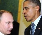 El presidente de EE.UU., Barack Obama (drcha), y su homólogo ruso, Vladimir Putin, se reúnen al margen de la Conferencia sobre el Cambio Climático (COP21) en la capital francesa de París. Foto: AP
