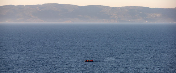 SIKAMINIAS, GREECE - NOVEMBER 12:  A migrant boat makes the crossing from Turkey to the Greek island of Lesbos on November 12, 2015 in Sikaminias, Greece. Rafts and boats continue to make the journey from Turkey to Lesbos each day as thousands flee conflict in Iraq, Syria, Afghanistan and other countries. Over 500,000 migrants have entered Europe so far this year and approximately four-fifths of those have paid to be smuggled by sea to Greece from Turkey, the main transit route into the EU. Most of those entering Greece on a boat from Turkey are from the war zones of Syria, Iraq and Afghanistan.  (Photo by Carl Court/Getty Images)