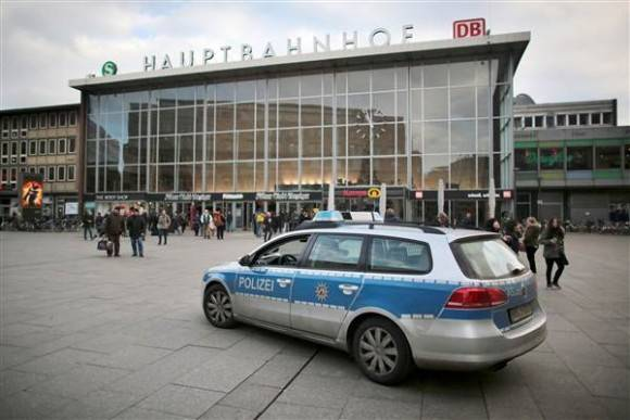 Police car drives past Cologne's main train station of Cologne on Tuesday. OLIVER BERG / DPA via AFP - Getty Images