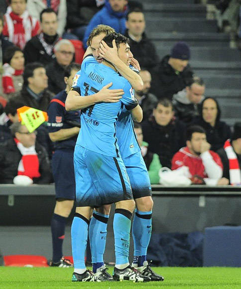 Rakitic felicita a Munir (AFP)