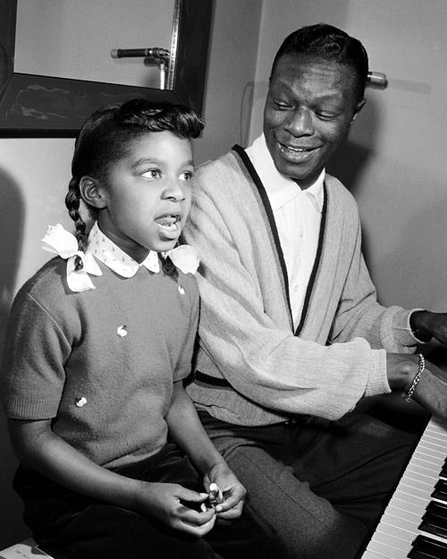 Natalie Cole, junto a su padre Nat King Cole.