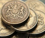 File photograph of a pile of one pound coins in central London