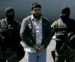 "Mexican federal police officers escort Alfredo Beltran Leyva, known as ""El Mochomo, upon his arrival at the Mexico City's airport, Monday, Jan. 21, 2008. Beltran was allegedly in charge of transporting drugs, bribing officials and laundering money for the Sinaloa drug cartel, led by Mexico's most-wanted alleged drug lord Joaquin Guzman. (AP Photo/Eduardo Verdugo)"