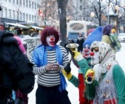 Anti-racist Loldiers of Odin clowns speak with police as they take to the streets against anti-immigration marchers in Tampere, Finland January 23, 2016. Police prevented the groups from confronting each other. On the northern fringes of Europe, Finland has little history of welcoming large numbers of refugees, unlike neighbouring Sweden. But as with other European countries, it is now struggling with a huge increase in asylum seekers and the authorities are wary of any anti-immigrant vigilantism.   REUTERS/Kalle Parkkinen/Lehtikuva    ATTENTION EDITORS - THIS IMAGE WAS PROVIDED BY A THIRD PARTY. FOR EDITORIAL USE ONLY. NOT FOR SALE FOR MARKETING OR ADVERTISING CAMPAIGNS. THIS PICTURE IS DISTRIBUTED EXACTLY AS RECEIVED BY REUTERS, AS A SERVICE TO CLIENTS. NO THIRD PARTY SALES. NOT FOR USE BY REUTERS THIRD PARTY DISTRIBUTORS. FINLAND OUT. NO COMMERCIAL OR EDITORIAL SALES IN FINLAND.