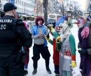 Anti-racist Loldiers of Odin clowns speak with police as they take to the streets against anti-immigration marchers in Tampere