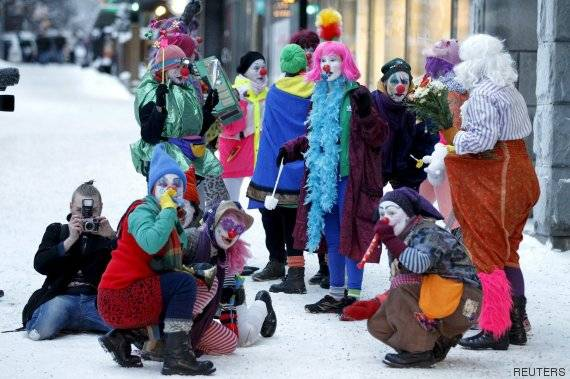 Members of anti-racist Loldiers of Odin clown group take to the streets against anti-immigration marchers in Tampere