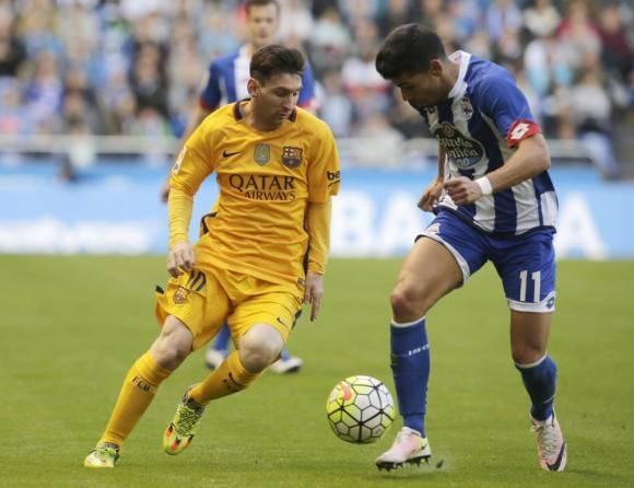 Messi y Juanfran Moreno Foto: Reuters