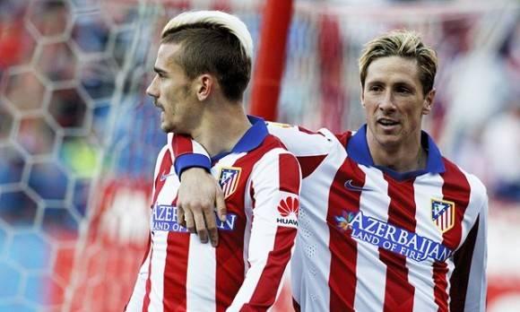 Griezmann (izquierda) y Torres se juntaron en la jugada del gol que clasificó al Atlético.