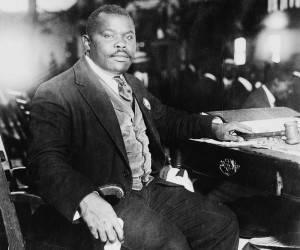 Marcus Mosiah Garvey (17 de agosto de 1887 – 10 de junio de 1940), una figura emblemática para la tradición negra mundial fue un predicador, periodista y empresario jamaicano y fue el fundador de la Asociación Universal para la Mejora del Hombre Negro (UNIA, por las siglas en inglés), con su lema One god, one aim, one destiny (Un dios, un objetivo, un destino).