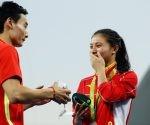 Clavadistas chinos se comprometen en podio olímpico