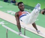 Manrique Larduet Bicet de Cuba,  compite en las barras paralelas del All Around de la gimnasia artística de los Juegos Olímpicos de Río de Janeiro, en el estadio Arena Olimpica, ubicado en el Parque Olímpico, en Barra de Tijuca, Brasil,  el 6 de agosto de 2016.  Foto: Roberto Morejón/ Jit.