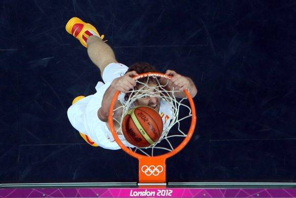 LONDON, ENGLAND - JULY 29: Pau Gasol #4 of Spain dunks the ball against China during their Men's Basketball Game on Day 2 of the London 2012 Olympic Games at the Basketball Arena on July 29, 2012 in London, England. (Photo by Rob Carr/Getty Images)