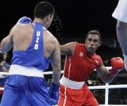Cuba's Arlen Lopez, right, fights Uzbekistan's Bektemir Melikuziev during a men's middleweight 75-kg final boxing match at the 2016 Summer Olympics in Rio de Janeiro, Brazil, Saturday, Aug. 20, 2016. (AP Photo/Frank Franklin II)