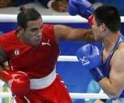 Cuba's Arlen Lopez, left, fights Uzbekistan's Bektemir Melikuziev during a men's middleweight 75-kg final boxing match at the 2016 Summer Olympics in Rio de Janeiro, Brazil, Saturday, Aug. 20, 2016. (AP Photo/Vincent Thian)