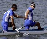 Serguey Torres y Fernando Dayan Jorge  celebran la victoria en la prueba. Foto: Matt York/ AP