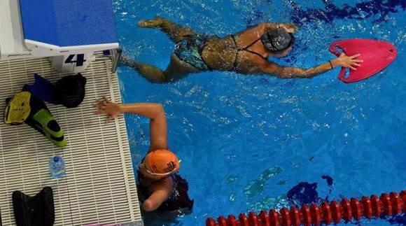 Parte del equipo ruso de natación, durante un entrenamiento. Foto: AFP.
