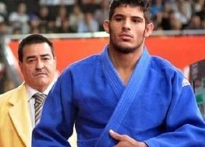 El judoca cubano Asley González y su entrenador.