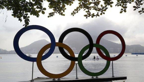 Athletes warm up for the final day of canoe sprint competition during the 2016 Summer Olympics in Rio de Janeiro, Brazil, Saturday, Aug. 20, 2016. (AP Photo/Matt York)