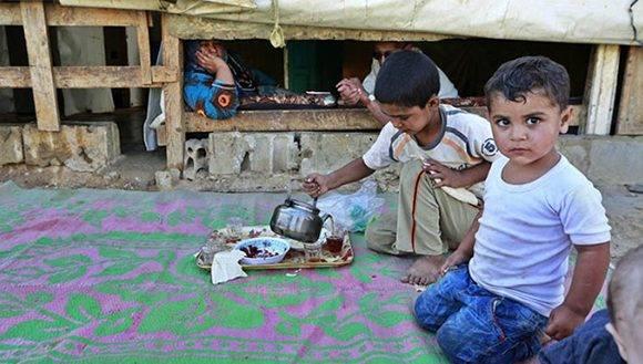 Los niños terminan siendo los más afectados por las políticas de los gobiernos capitalistas. Foto: EFE.