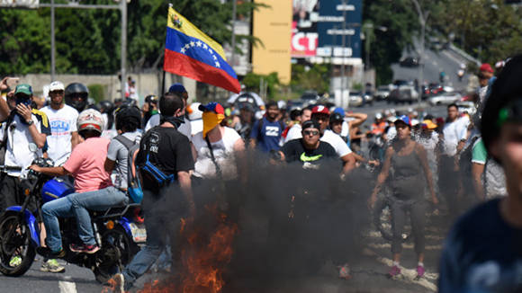 Los actos de violencia los protagonizó la oposición. Foto: Juan Baretto/ AFP.