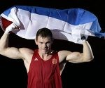 Russia's Egor Mekhontcev, RED, fights Kazakhstan's Adilbek Niyazymbetov, BLUE, during their men's light heavyweight 81-kg gold medal boxing match at the 2012 Summer Olympics, Sunday, Aug. 12, 2012, in London. (AP Photo/Ivan Sekretarev)