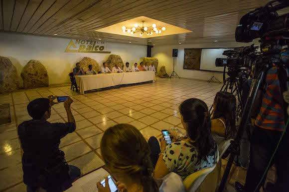 Reporters attend a joint statement given by the Revolutionary Armed Forces of Colombia, FARC, and the Colombian government in Havana, Cuba, Friday, Oct. 7, 2016. (AP Photo/Desmond Boylan)