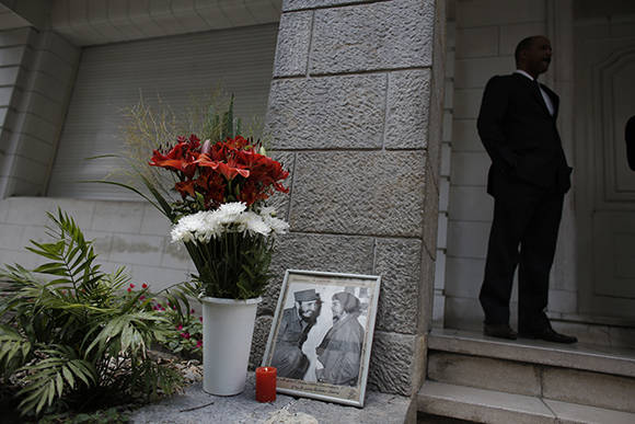 "A photo of the late Fidel Castro, pictured on left of frame, with Ernesto ""Che"" Guevara, is propped against a wall at the entrance of the Cuban Embassy in Buenos Aires, Argentina, Monday, Nov. 28, 2016. Castro, who led a rebel army to improbable victory, embraced Soviet-style communism and defied the power of 10 U.S. presidents during his half century rule of Cuba, died Friday at age 90. (AP Photo/Victor R. Caivano)"