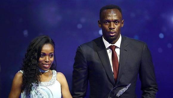 Ayana y Bolt al recibir sus galardones. Foto: EFE.