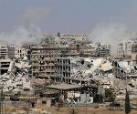 TOPSHOT - Smoke billows from buildings during an operation by Syrian government forces to retake control of the rebel-held district of Leramun  on the northwest outskirts of Aleppo  on July 26  2016  The Syrian Observatory for Human Rights said on July 26 loyalist troops had full control of the Leramun district after heavy clashes  and reported fighting for neighbouring Bani Zeid  which is also held by rebels    AFP PHOTO   GEORGE OURFALIAN