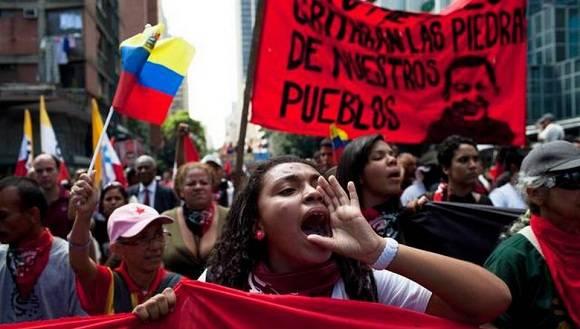 Chavistas salen a las calles en protestas contra desestabilización opositora. Foto: AP.