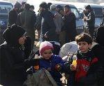 Sirios evacuados de las últimas zonas rebeldes en el norte de Alepo. Foto: AFP.
