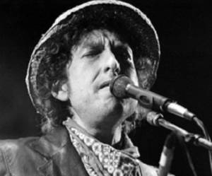 "(FILES) This file photo taken on June 3, 1984 shows shows US singer Bob Dylan performing during a concert at the Olympic stadium in Munich, southern Germany. Music icon Bob Dylan will not attend the Nobel ceremony in December to accept his literature prize because he has ""other commitments"", the Swedish Academy said on Noverber 16, 2016 / AFP PHOTO / DPA / Istvan Bajzat / Germany OUT"
