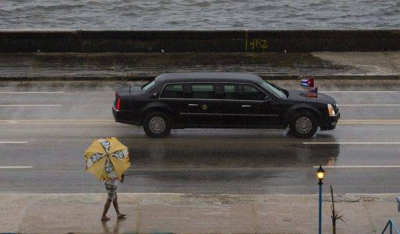 The vehicle carrying President Barack Obama drives along the Malecon sea wall on its way to Old Havana, Cuba, Sunday, March 20, 2016. Obama's trip is a crowning moment in his and Cuban President Raul Castro's ambitious effort to restore normal relations between their countries. (AP Photo/Desmond Boylan)