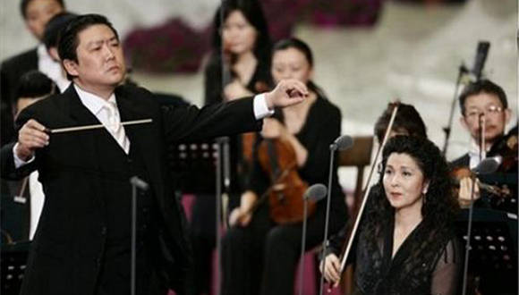 "China Philharmonic Orchestra Soprano Lan Rao, at right, looks on as Conductor long Yu performs, at left,  with other members of the orchestra, during a concert in Pope Paul VI hall at the Vatican, Wednesday, May 7, 2008. The China Philharmonic Orchestra performed for the pontiff in a landmark concert Wednesday that could indicate warming relations between Beijing and the Vatican. Benedict called it a ""truly unique event"" and offered a ""thank you"" in Chinese at the end of the hour-long concert. (AP Photo/Plinio Lepri)"